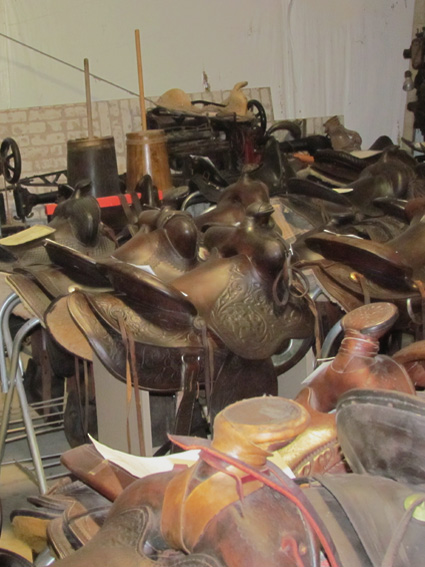 Vintage Saddles with Equipment in background